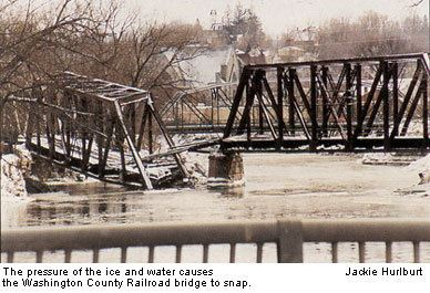 The pressure of the ice and water causes the Washington County Railroad bridge to snap